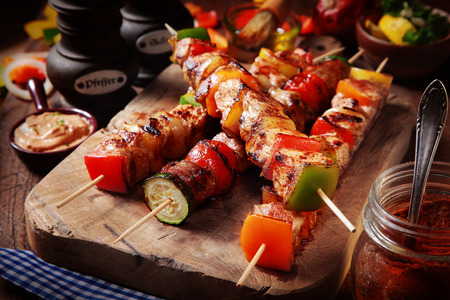Close up Mouth Watering Gourmet Barbecue on Wooden Chopping Board at the Table.