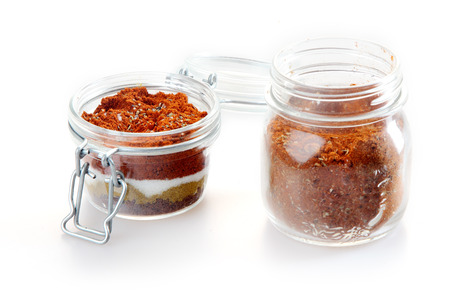 Close up Rub and Marinade Powder on Glass Jars, Isolated on White Background.