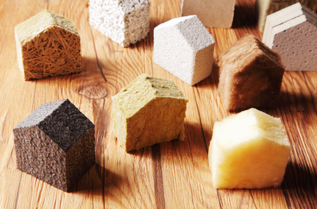 Photo pour Close up Various Scattered Blocks of insulation Model Hous in Different Standing on Top of the Wooden Table - image libre de droit