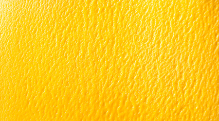 Photo for Overhead background texture of colorful orange tropical mango sorbet ice cream in a full frame wide angle view - Royalty Free Image