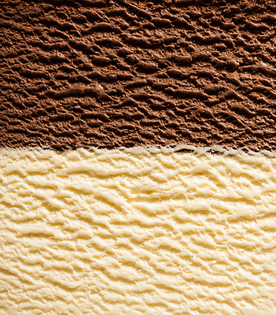 Foto de Full Frame background texture of half and half vanilla bourbon and chocolate ice cream divided neatly in the center viewed from above - Imagen libre de derechos
