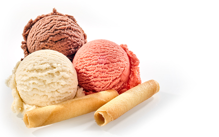 Photo for Three scoops of delicious homemade frozen italian dessert against a white background beside wafer rolls - Royalty Free Image