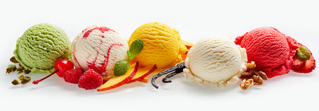 Set of ice cream scoops of different colors and flavours with berries, nuts and fruits decoration isolated on white background