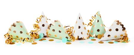 Foto de Carnival theme of party hats with ribbons against white background - Imagen libre de derechos