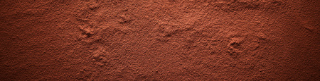 Foto de Cocoa powder surface banner, viewed in full frame from above with darkened vignette effect - Imagen libre de derechos