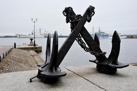 black cast iron anchor at the pier in Kronstadt, Saint Petersburg