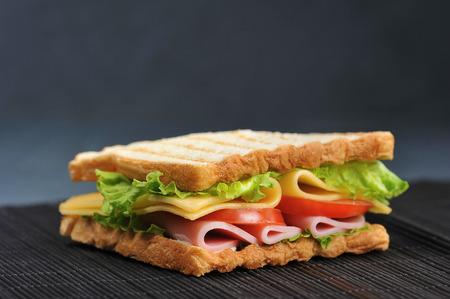 Photo pour ham and cheese sandwich on a dark background - image libre de droit
