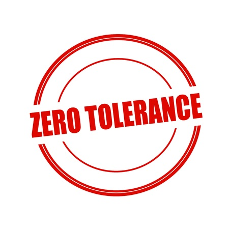 ZERO TOLERANCE red stamp text on circle on white background