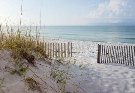 Landscape of dunes, beach and ocean at sunrise on the Gulf of Mexico