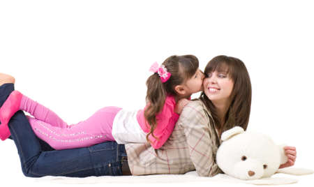 Happy family, young beautiful mother and her little daughter on  bear