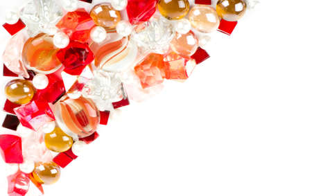 Beautiful bright colorful stones and pearl on a white background