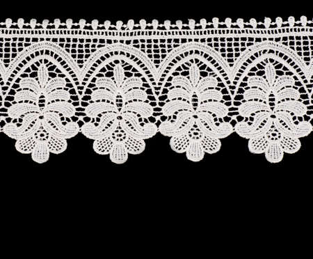 Vintage white lace with flowers on black background