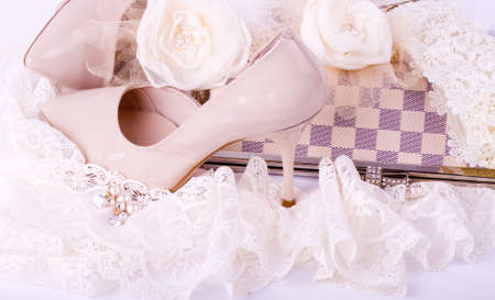 Photo for The beautiful bridal shoes, lace, bag and beads - Royalty Free Image