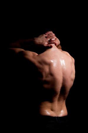 Fashionable muscular man in a fashion pose