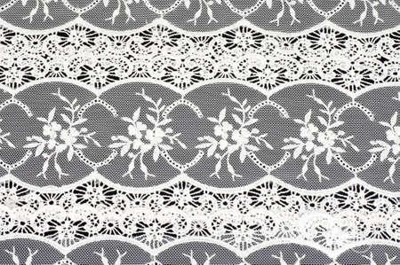 Photo pour Vintage lace with flowers on black background - image libre de droit