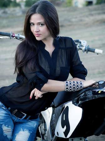 Sexy beautiful girl with motorbike