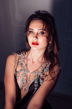 Foto de Portrait of beautiful young brunette woman with makeup in fashion clothes - Imagen libre de derechos
