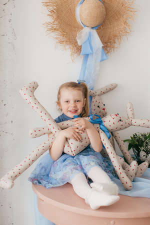 Photo for Cute little girl with a bunny rabbit at Easter. - Royalty Free Image
