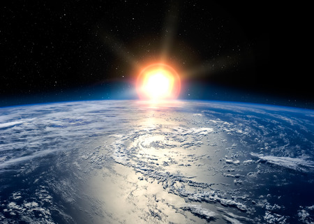 Earth with the rising sun.