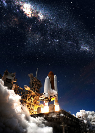 Space shuttle taking off on a mission.