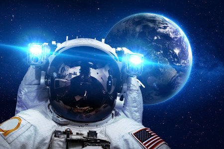 Photo for Astronaut in outer space against the backdrop of the planet.  - Royalty Free Image