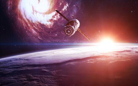 Photo pour Spacecraft at earth orbit - image libre de droit