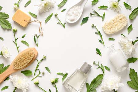 Spa floral background, flat lay of various beauty care products decorated with simple white flowers, blank space for your textの写真素材