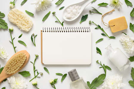 Photo for Spa floral background, flat lay of various beauty care products decorated with simple white flowers, paper note with a blank space for your text - Royalty Free Image