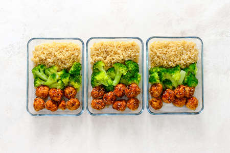 Photo pour Asian style teriyaki sauce chicken meat balls with broccoli and rice prepared and put in a take away lunch boxes, view from above - image libre de droit