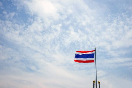 Thailand flag on a pole on the sky