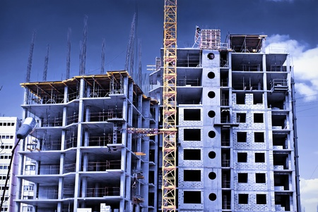 Photo for Construction site in the open air. Crane and unfinished buildings. - Royalty Free Image