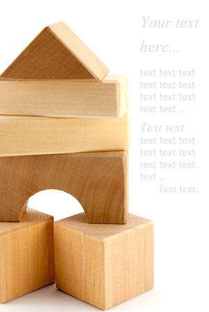 Photo pour The composition of toy geometrical shapes over white background. - image libre de droit
