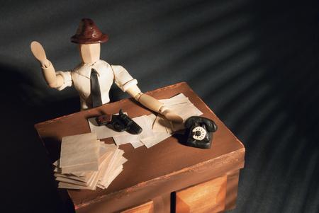 Classic wooden dummy in noir detective scene.