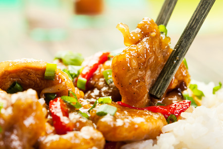 Photo pour Sirloins on sweet and sour sauce served with boiled rice - image libre de droit