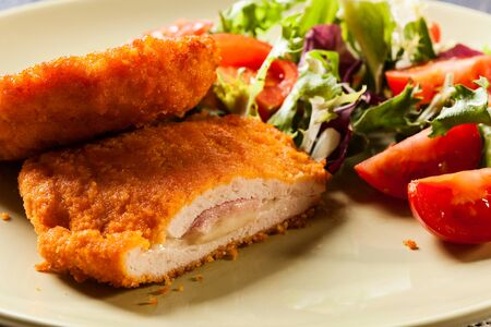 Cutlet Cordon Bleu with salad on a plate