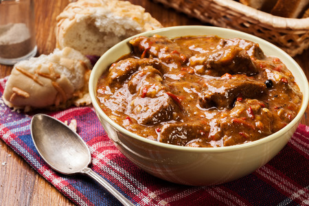 Beef stew served with crusty bread in a bowl