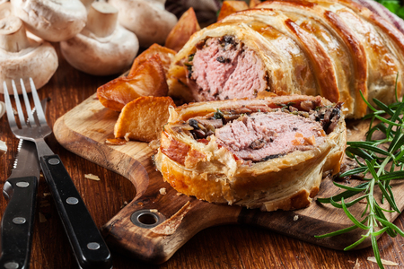 Pork tenderloin in wellington style with mushrooms in puff pastry