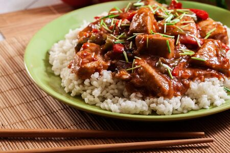Foto de Delicious chicken in sweet and sour sauce served with rice - Imagen libre de derechos