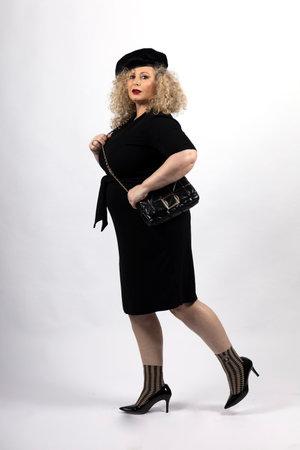 Foto de mature plus size model woman wearing black clothes, xxl woman on white background - Imagen libre de derechos
