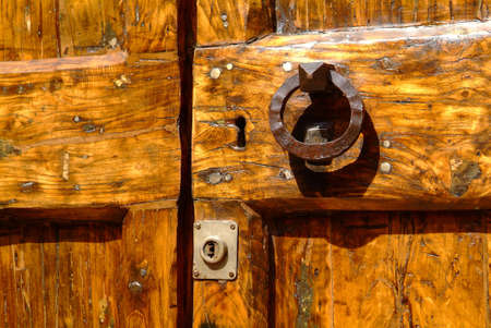 brown wooden door with rusty old door handle
