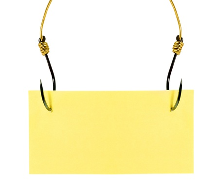 Yellow sticky note with fish hook solated on white background