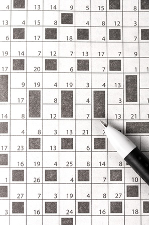 Crossword in newspaper concept and idea written pen