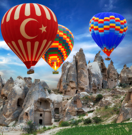 Hot air balloon turkey flag flying mountain valley Cappadocia Turkey