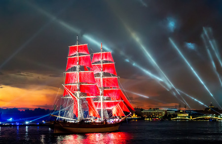 frigate with scarlet sails floating on the Neva River. Holiday Scarlet sails in St.Petersburg