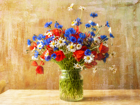 Still life with bouquet of colorful wild flowers