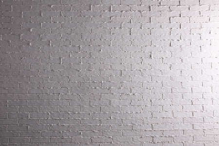 Photo for Brick painted white and properly illuminated reflects the interesting climate of its structure. - Royalty Free Image