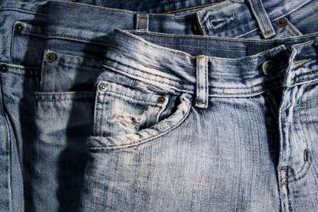 Foto de Worn and washed out jeans, front side. - Imagen libre de derechos