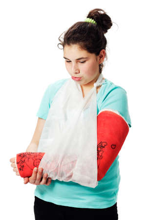 Girl with plaster cast pouting.