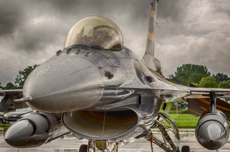 F16 Fighter jet shown against stormy skies and rain