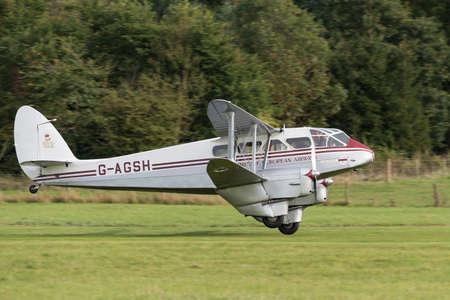 Biggleswade UK - 5th October, 2014: De Havilland, Dragon Rapide vintage bi-plane at the Shuttleworth Collection airshow